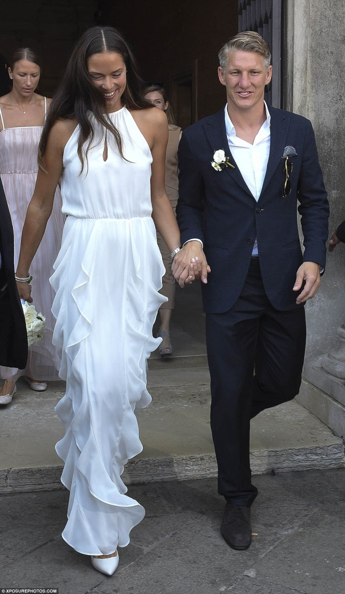Good sports! Serbian tennis player Ana Ivanovic wowed in white as she married German footballer Bastian Schweinsteiger on Tuesday in an intimate ceremony at Venice City Hall