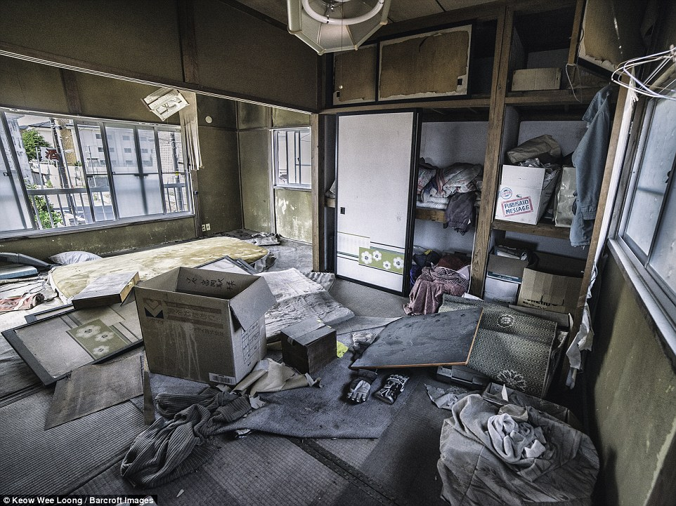 The urban explorers wore masks as they entered abandoned houses, like this one in Futaba, that's untouched since the disaster in 2011