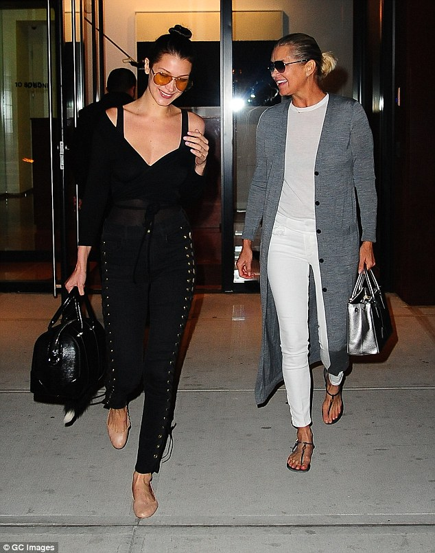 Fun times: Earlier that same day she was pictured with her mother Yolanda, but Bella mixed her outfit up with nude pumps and different sunglasses