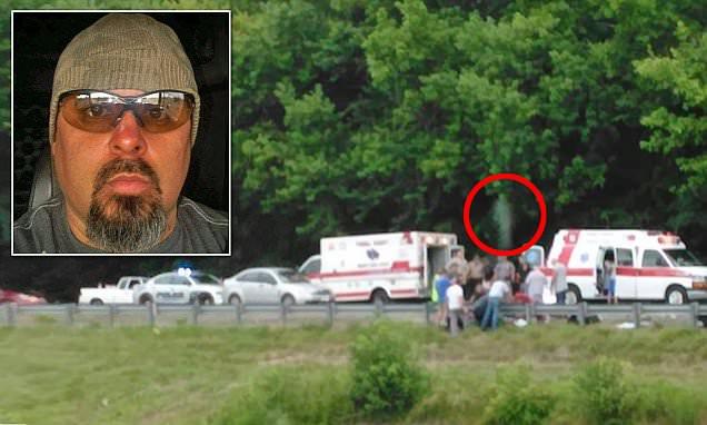 Kentucky man's eerie image of fatal motorbike crash showing ghostly figure above victim