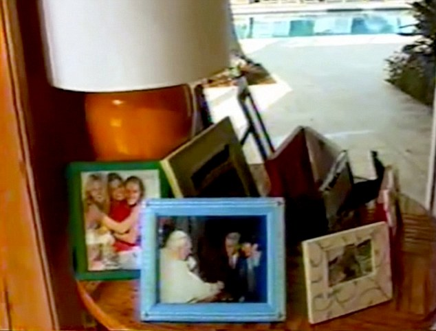 In another non-risque photo in the home, Epstein and another person can be seen meetingPope John Paul II