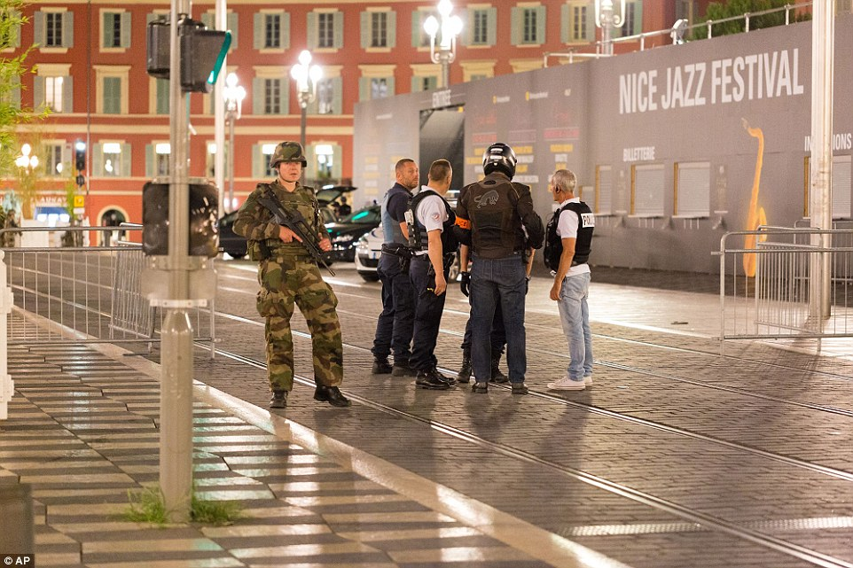 Police officers and armed soldiers stood guard as the city was put on lockdown as several dozen people were killed in the attack