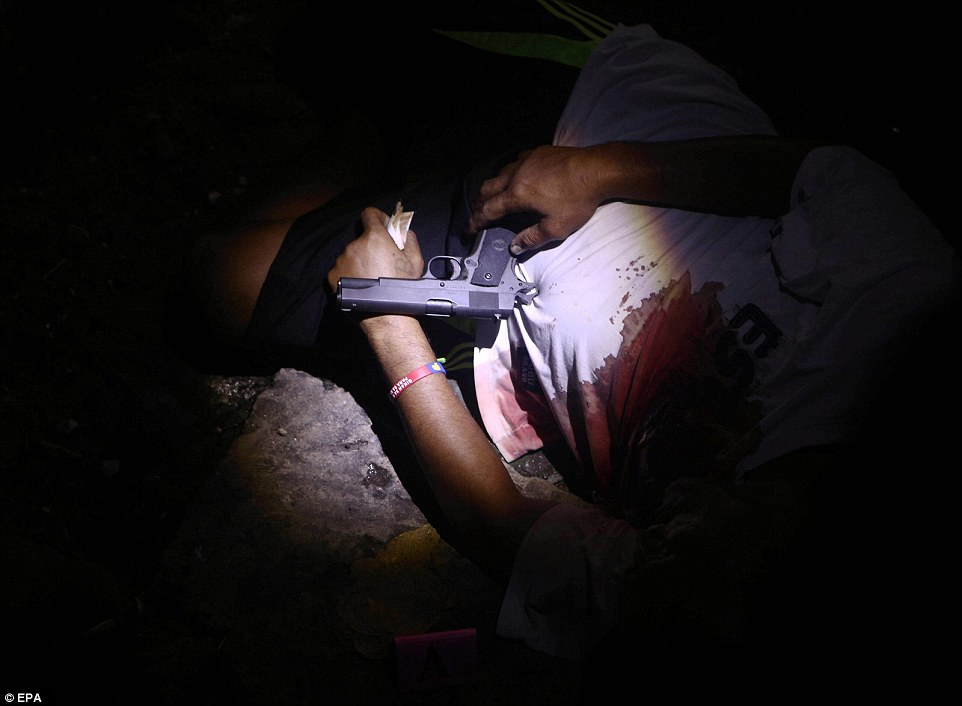 Picture shows the body of a killed Filipino allegedly involved in illegal drugs. Police have confirmed killing more than 110 drug suspects since president Duterte came to power