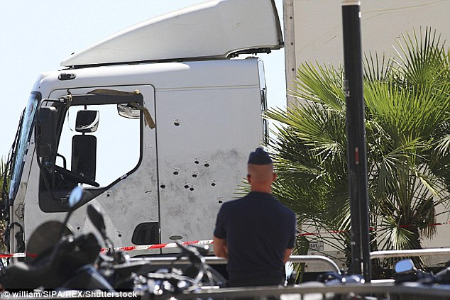 End: The police said that French Tunisian Mohamed Lahouaiej Bouhlel died in the passenger seat of this 19-tonne truck after a shoot-out