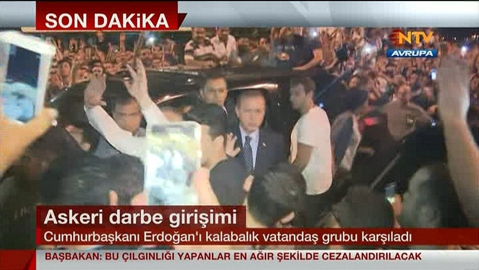 President Recep Erdogan, pictured centre,  made a triumphant return to Istanbul following a botched military coup in Turkey