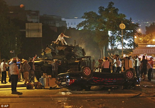 Lawyer Robert Amsterdam, whose firm represents the Republic of Turkey, named Gulen and said there were 'indications of direct involvement' (pictured, people attempting to stop a tank in Ankara)