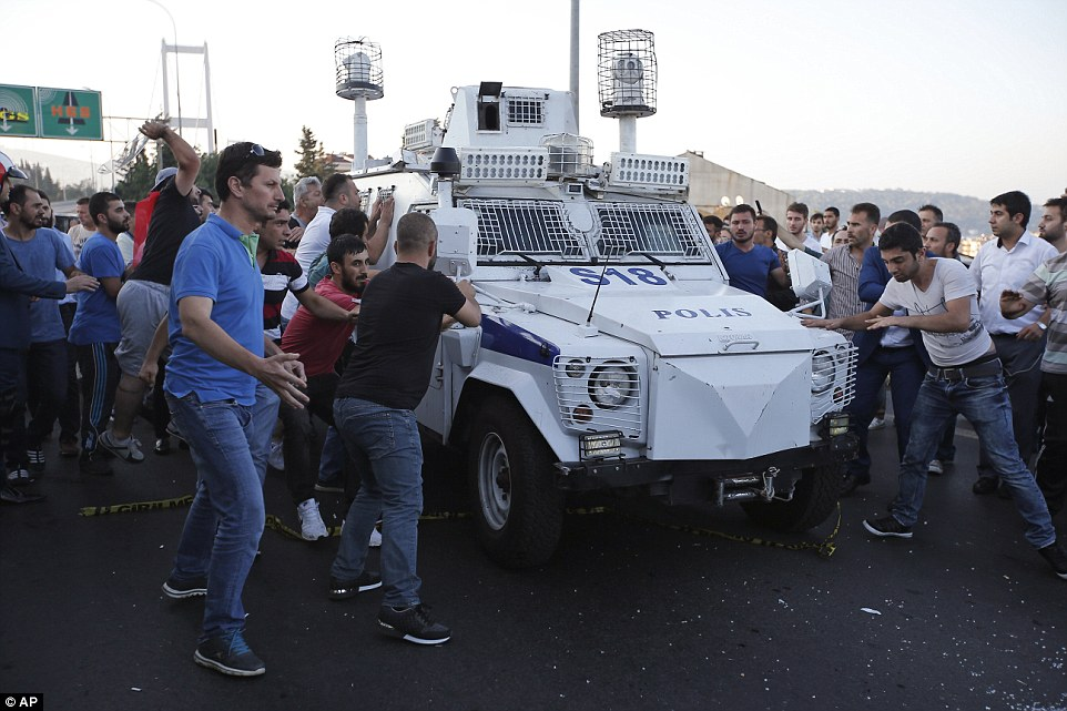Civilians launch an attack on an armoured police car carrying Turkish soldiers who participated in the coup against President Erdogan