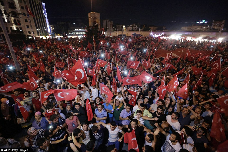 In Taksim square, which was occupied by troops on Friday, thousands of people waved flags and sang patriotic songs