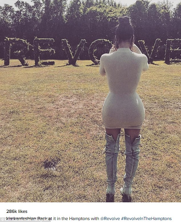 Party time: Kim shared a rear-view photo as she posed the skintight dress