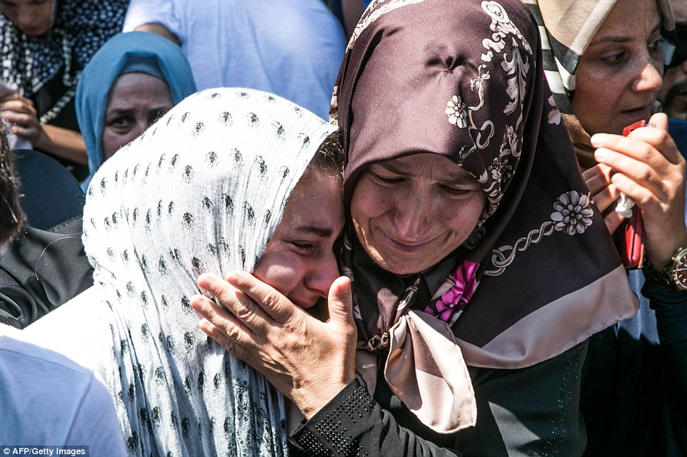 Women fight to hold back the tears during the funeral of a victim killed during the attempted coup by Turkish military members