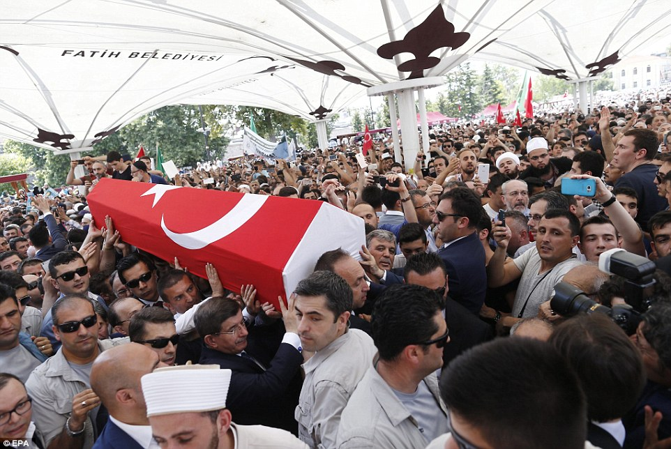 Crowds chanted 'Fethullah will come and pay,' 'Allah is Great' and 'We want the death penalty'. Pictured, mourners carry a coffin