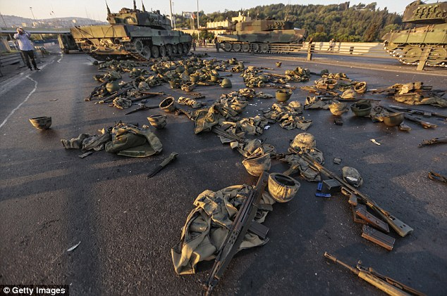Surrender: Clothes and weapons beloging to soldiers involved in the coup attempt that have now surrendered lie on the ground abandoned on Bosphorus Bridge