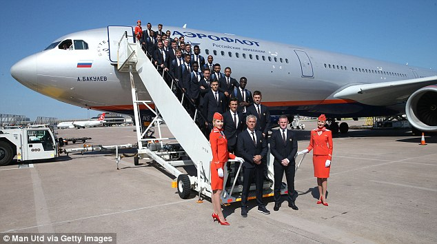 Manchester United's players and Jose Mourinho pose for a picture ahead of their flight to China on Tuesday
