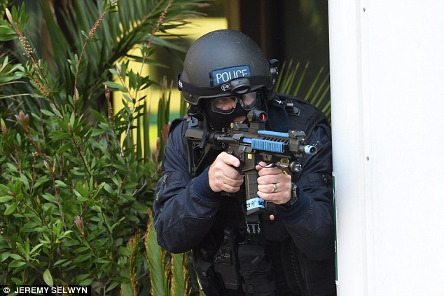Police take part in a firearms exercise at Scotland Yard's training centre. Some 103 attacks were carried out, planned or foiled in the UK last year, according to the report
