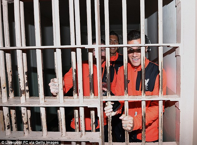 Alberto Moreno, Roberto Firmino and Philippe Coutinho (left to right) fool around inside a cell at Alcatraz