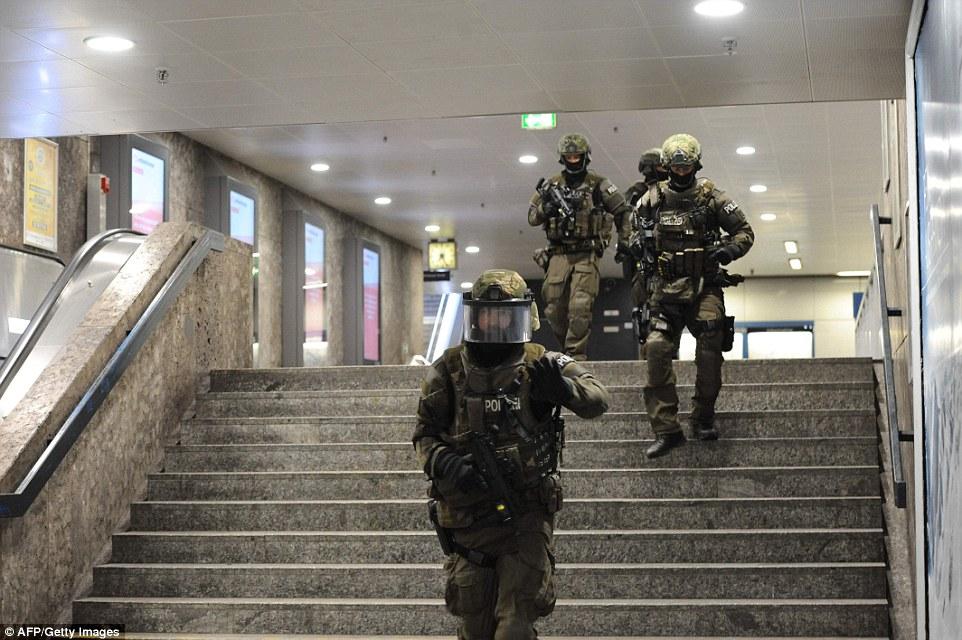 Police walks inside a subway station Karlsplatz (Stachus) near a shopping mall following a shooting on July 22, 2016 in Munich