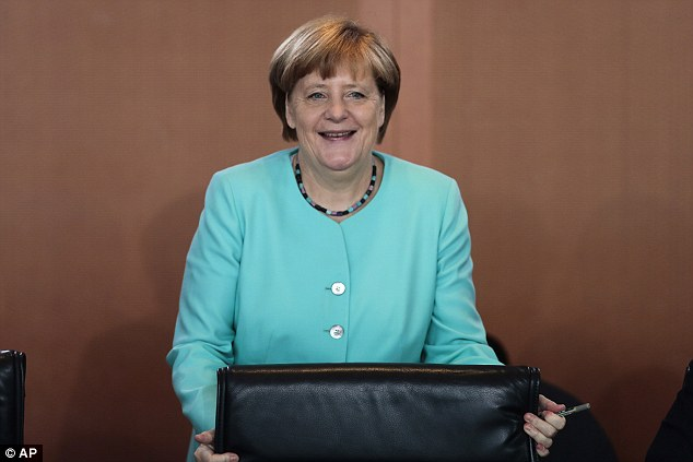 German Chancellor Angela Merkel arrives for the last cabinet meeting prior to her summer vacations at the chancellery in Berlin, Germany, this week