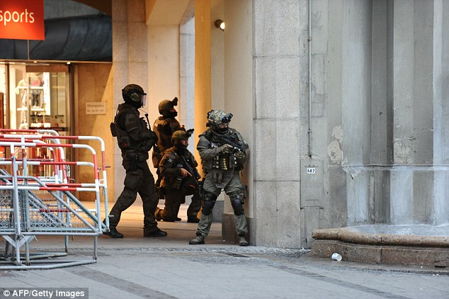 Police secures the area of subway station Karlsplatz near a Munich shopping mall yesterday following the shooting rampage which put the area into lockdown while police hunted the attackers
