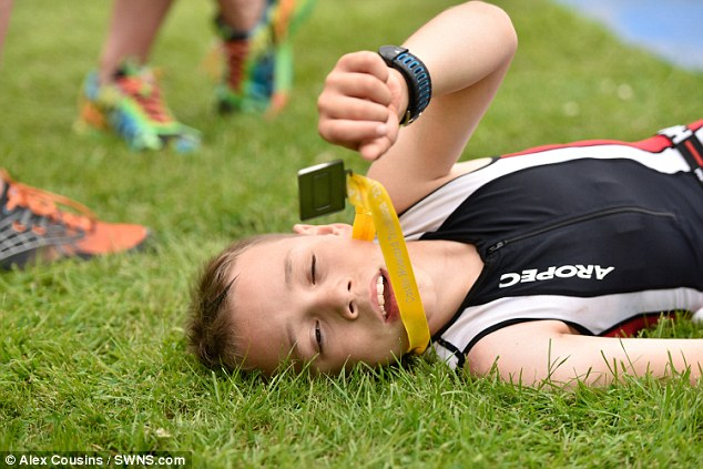 Triumph: An ecstatic Bailey was seen lying on the ground clutching his medal