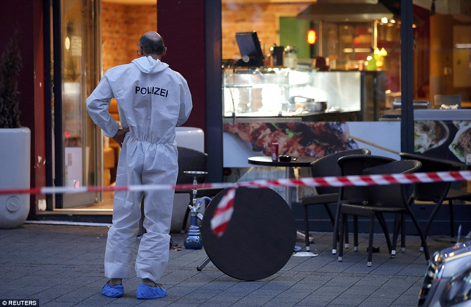 Forensic investigators were seen working outside the restaurant where the attack took place and scouring the area for evidence