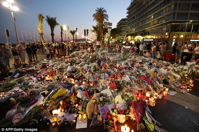 Hundreds of mourners laid flowers candles and messages at a makeshift memorial following the attack