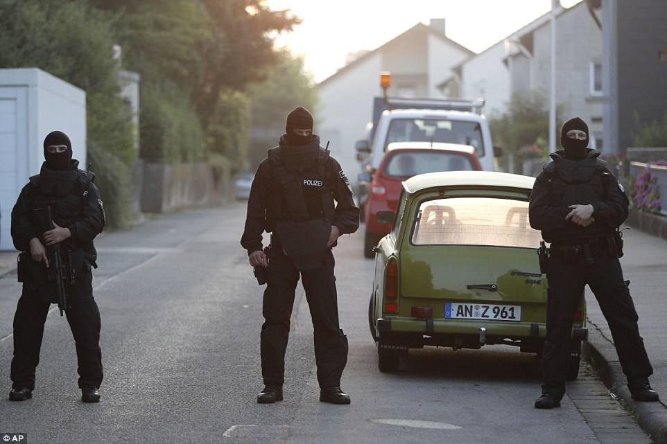 Sealed off: Special police officers secure a street near the house where the Syrian man, a failed asylum seeker, lived in Ansbach
