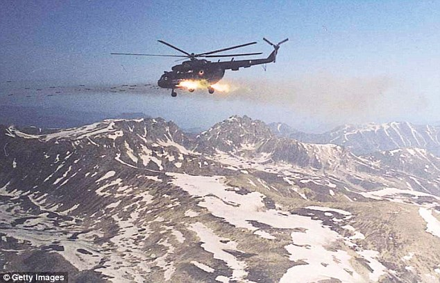 An Indian Air Force Mi-17 helicopter attacks Pakistan-backed guerrilla positions in the Kargil sector of India (file picture)