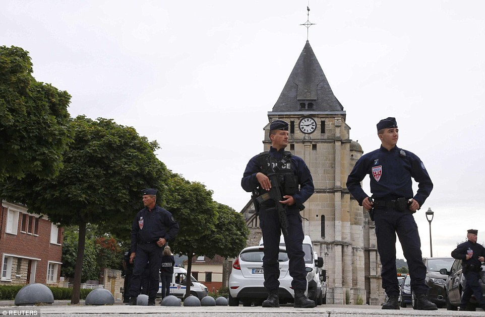 French CRS police stand guard in front of the church a day after a hostage-taking in Saint-Etienne-du-Rouvray near Rouen in Normandy, France, where French priest, Father Jacques Hamel, was killed with a knife and another hostage seriously wounded