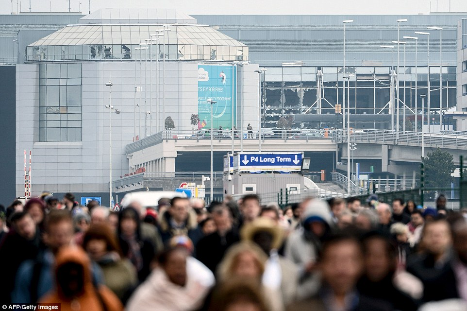 Passengers evacuate the Brussels Airport, in Zaventem, on March 22, 2016, after a string of explosions killed 35 people
