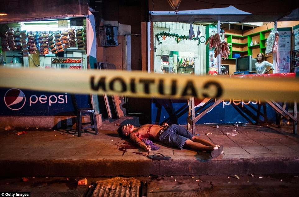 A man is seen shot dead outside of a local shop in Manila and was another alleged drug dealer