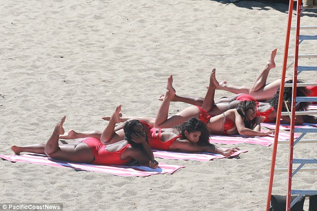 Leggy display: The ladies flaunted their fit pins while looking sexy on the sand