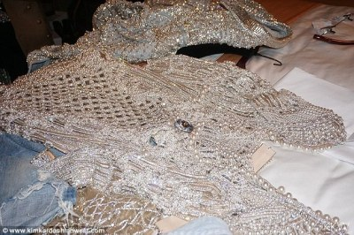 Pearly and pretty:The third photo is of the first dress laid out on the hotel bed over a pair of torn jeans