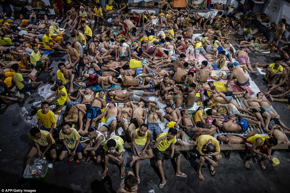 Eye-opening images reveal the daily life inside Quezon City jail in Manila, the capital of the Philippines; where 3,800 inmates serve time behind the walls of a prison built for just 800