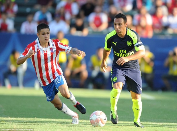 Santi Cazorla (right) was in fine fettle against Chivas and helped set up the first goal with a great delivery