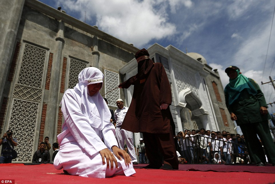 Under the law men and women, who are not spouses, are not allowed to get too close due to the 'khalwat' offence - and punishment is by public caning