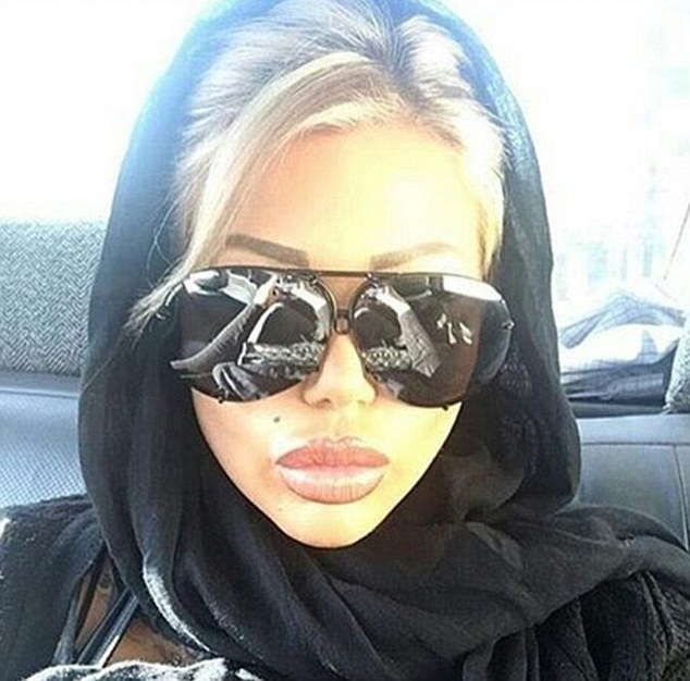 British porn star Candy Charms who posted a picture of herself in the back of a cab in Tehran wearing a hijab, after visiting the country to have plastic surgery