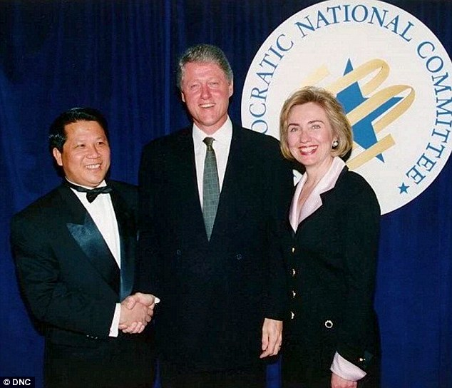 Communist frontman? Ng Lap Seng was seen shaking hands with Bill Clinton in a picture taken before the revelation of illegal money being donated to the 1996 Clinton campaign