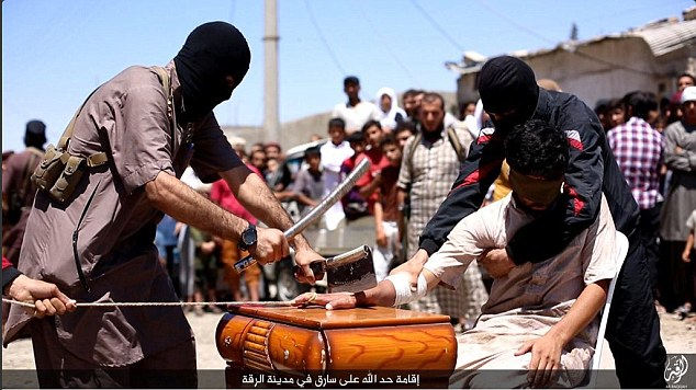 Brutality: A recent ISIS video showsIslamic State religious police reportedly chopping off the hand of an alleged thief in Raqqa, Syria
