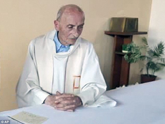 Police are hunting for a Moroccan man who attacked a Catholic priest at a cafe in Spain, just a week after the murder of French priest Father Jacques Hamel by ISIS jihadis