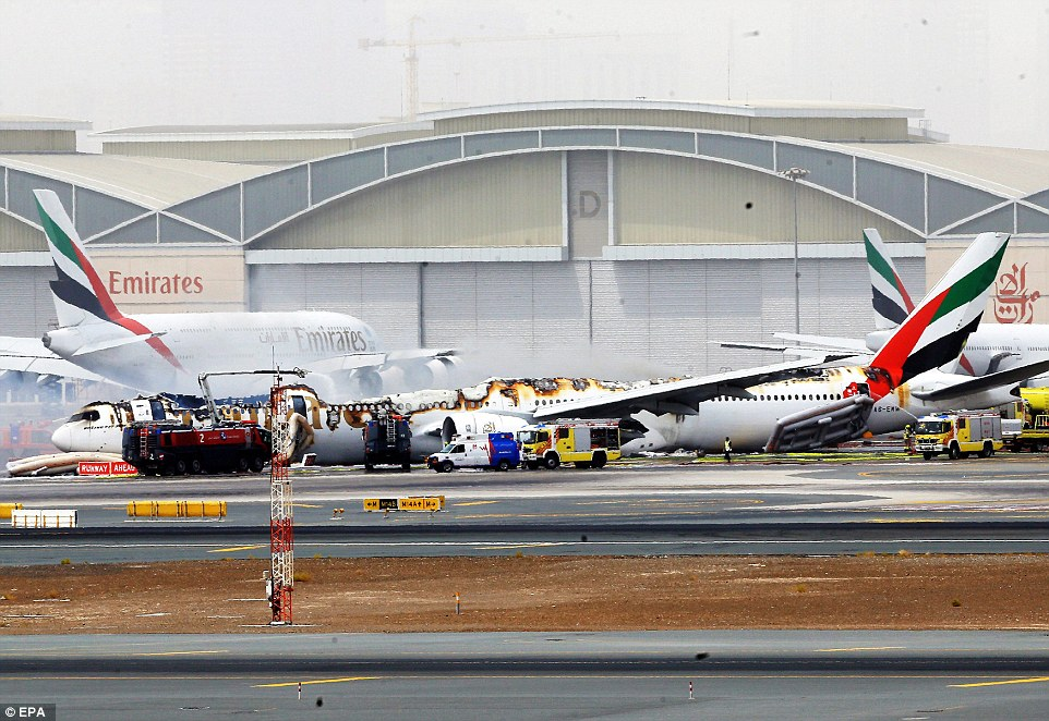 Emirates airlines Boeing 777-300 A6-EMW plane flight number EK521 from Trivandrum to Dubai lays on the ground in Dubai airport after being gutted by fire