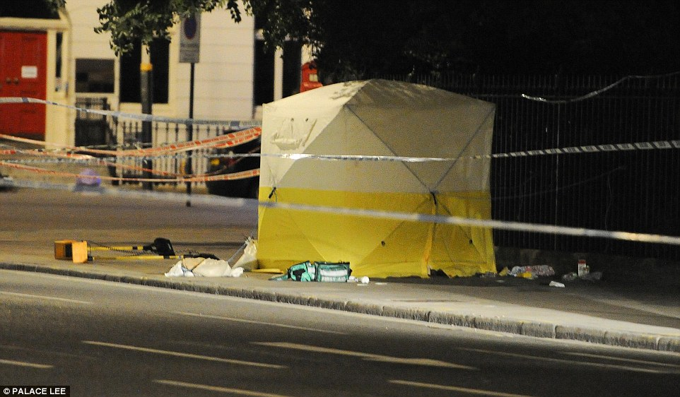 A woman has died and up to five people have been injured after a man allegedly 'went on the rampage' with a knife in a possible terror-related attack in London. Pictured: A forensic tent thought to be covering the woman's body in Russell Square