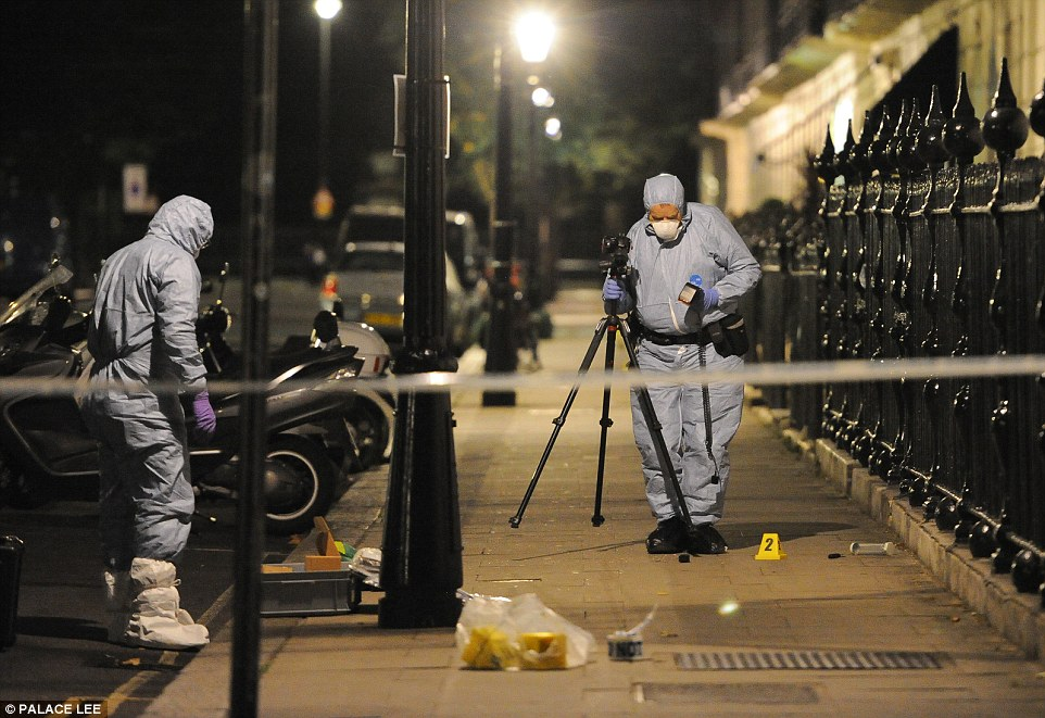 Forensic officers have remained at the scene into the early hours to gather evidence after a woman died and five others were injured when a man 'went on the rampage' and began 'injuring people with a knife' near a park in Russell Square, London