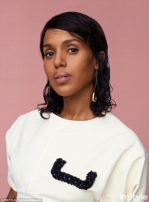Keeping it simple: The Scandal star donned a white Celine T-shirt with a black sequin design on the front and statement Leigh Miller earrings