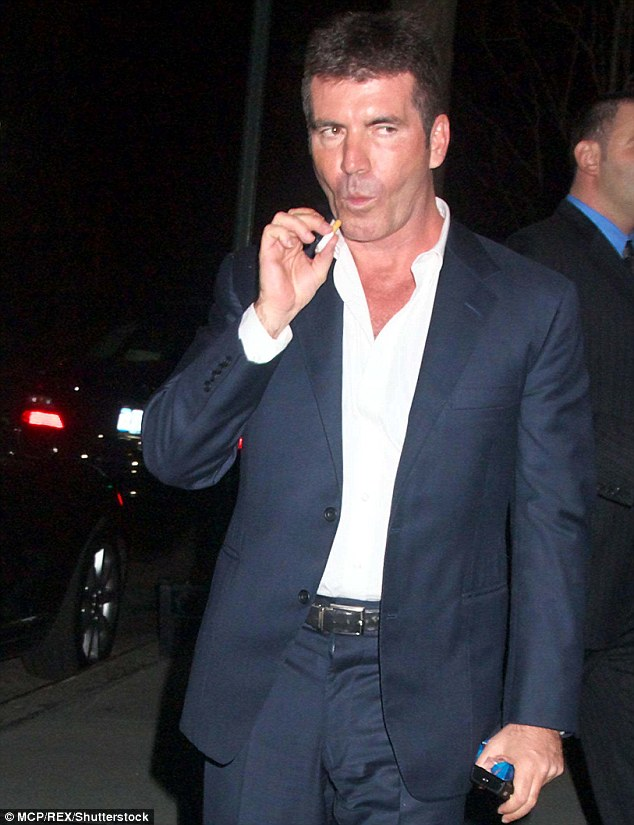 Simon Cowell has revealed he's turned to E-cigarettes in a bid to finally quit smoking for the sake of his young son