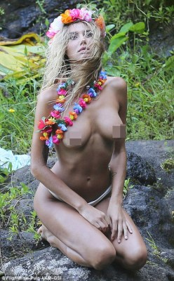 Chilling: Justin's rumoured flame Sahara Khan looked at peace as she rested topless on a rock