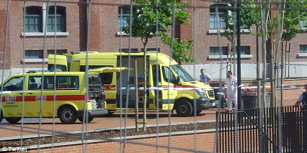 Emergency services raced to the scene in Charleroi, Belgium, where two female officers were wounded