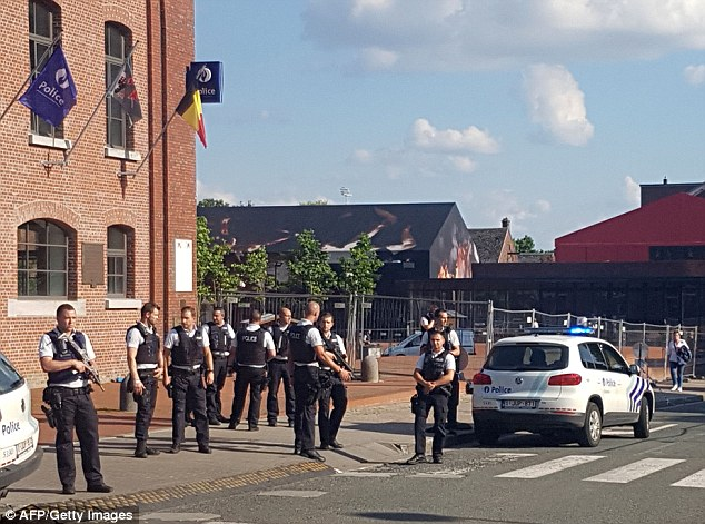 Armed police officers were seen surrounding the area near the police station in Charleroi after the attack