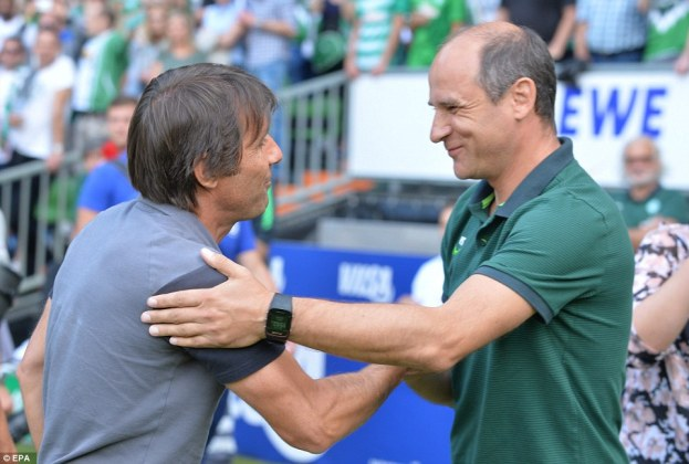 Antonio Conte and Viktor Skrypnk shake hands moments before seeing their teams involved in the high-scoring affair