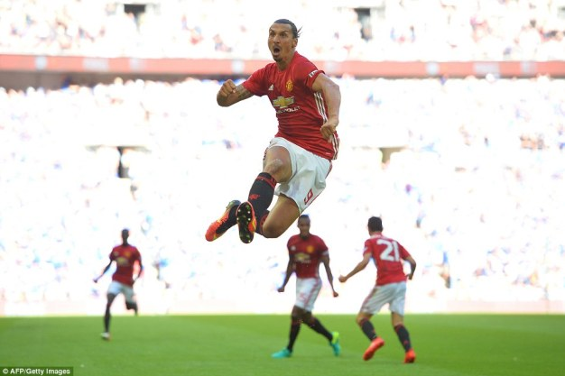 Zlatan Ibrahimovic roars with delight after scoring a late winner for Manchester United in the Community Shield