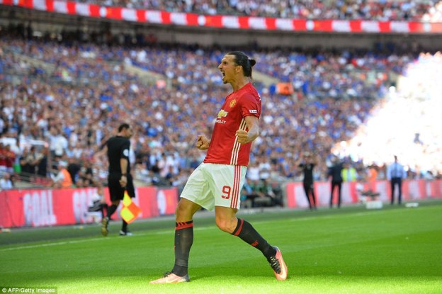 Running over to the fans inside Wembley Stadium, Swede Ibrahimovic screams with delight after his winner